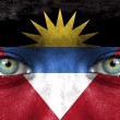 Stock Photo: Humface painted with flag of Antiguand Barbuda