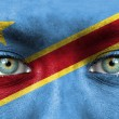 Stock Photo: Humface painted with flag of Democratic Republic of Congo