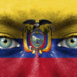 Human face painted with flag of Ecuador — Stock Photo