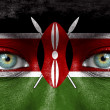 Human face painted with flag of Kenya — Stock Photo #11332884