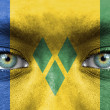 Stock Photo: Humface painted with flag of Saint Vincent and Grenadines