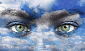 Blue human eyes with sky pattern — Stock Photo