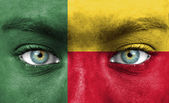 Human face painted with flag of Benin — Stock Photo