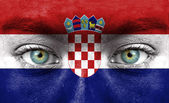 Human face painted with flag of Croatia — Stock Photo