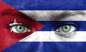 Human face painted with flag of Cuba — Stock Photo