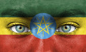 Human face painted with flag of Ethiopia — Stock Photo