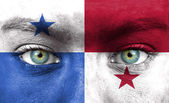 Human face painted with flag of Panama — Stock Photo