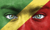 Human face painted with flag of Republic of the Congo — Stock Photo