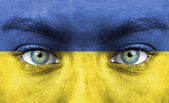 Human face painted with flag of Ukraine — Stock Photo