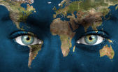 Human face painted with planet earth — Stock Photo