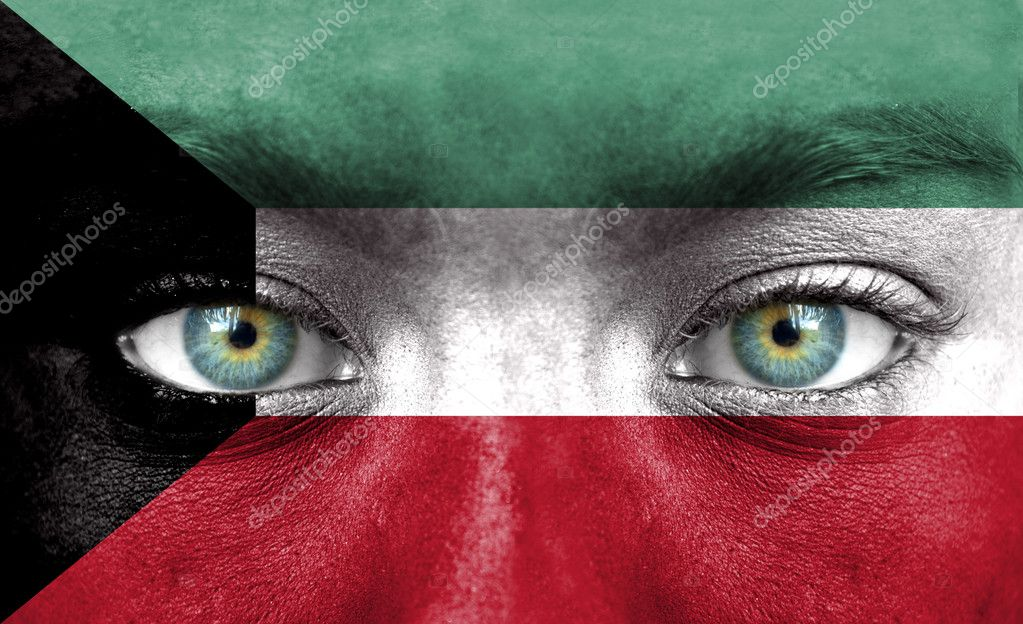 Human face painted with flag of Kuwait — Stock Photo #11332945