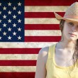 Cowgirl against American flag - Stock Photo