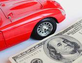 Red car and money — Stock Photo