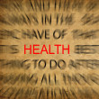 Blured text on vintage paper with focus on HEALTH — Stock Photo #11487901