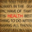 Blured text on vintage paper with focus on HEALTH — Stock Photo