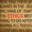 Blured text on vintage paper with focus on ETHICS — Stock Photo