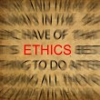 Stock Photo: Blured text on vintage paper with focus on ETHICS