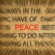 Blured text on vintage paper with focus on PEACE — Stock Photo