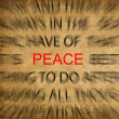 Blured text on vintage paper with focus on PEACE - Stock Photo