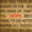 Stock Photo: Blured text on vintage paper with focus on HOPE