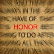 Stock Photo: Blured text on vintage paper with focus on HONOR