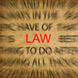 Stock Photo: Blured text on vintage paper with focus on LAW