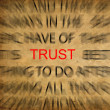 Blured text on vintage paper with focus on TRUST — Stock Photo