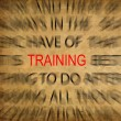 Blured text on vintage paper with focus on TRAINING — Stock Photo