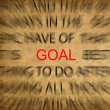 Blured text on vintage paper with focus on GOAL — Stock Photo