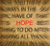 Blured text on vintage paper with focus on HOPE — Stock Photo