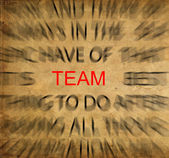 Blured text on vintage paper with focus on TEAM — Stock Photo