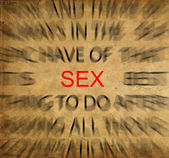 Blured text on vintage paper with focus on SEX — Stock Photo