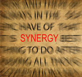 Blured text on vintage paper with focus on SYNERGY — Stock Photo
