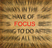 Blured text on vintage paper with focus on FOCUS — Stock Photo