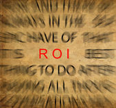 Blured text on vintage paper with focus on ROI ( Return of inves — Foto Stock