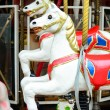 Carousel - Fair conceptual background with horses - Stok fotoğraf