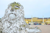 Schonbrunn palace in Vienna Austria - Entrance view with lion st — Stock Photo