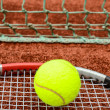 Tennis racket with ball - Stock Photo