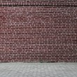 Grungy urban background of a brick wall — Stock Photo