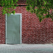 Stockfoto: Gray old metal door texture with iron handle and brick wall arou