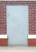 Brick wall with door background — Stock Photo