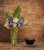 Still-life bouquet of lily of the valley with blue irises — Stock Photo