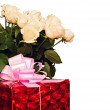 Stock Photo: Beautiful roses and gift box isolated on white background