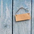 Wooden board hanging on the wall — Stock Photo