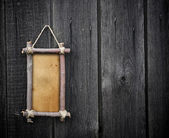 Wooden board hanging on the wall — Stok fotoğraf
