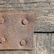 Empty rust metal plate on wooden background — Stock Photo