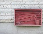 Fire fighting equipment on brick wall — ストック写真