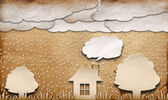 Rainy view recycled paper craft stick on brown background — Stock Photo