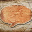 Blank recycled paper speech bubble on wood background — Foto Stock