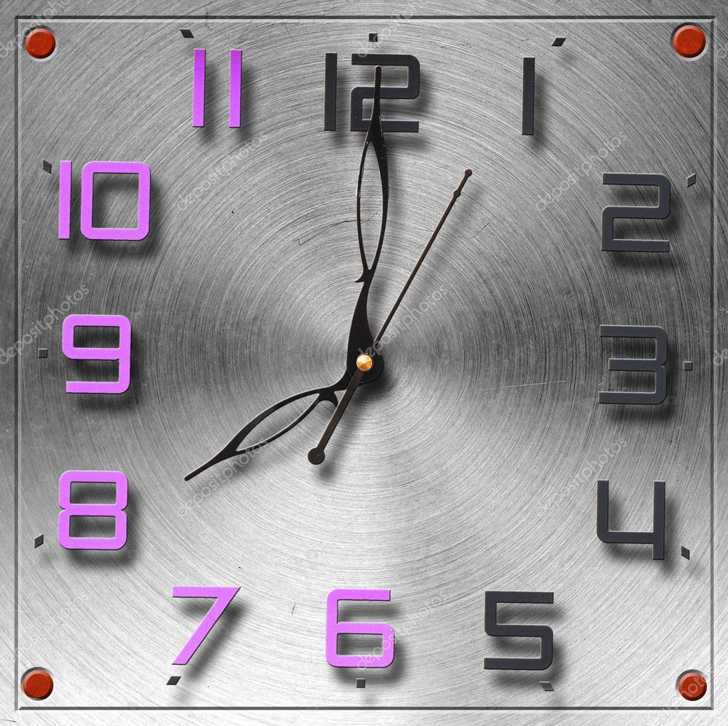 Modern clock on circular metal brushed texture — Stock Photo #11973925